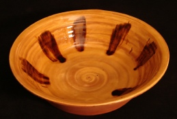 large redware serving bowl with black drips