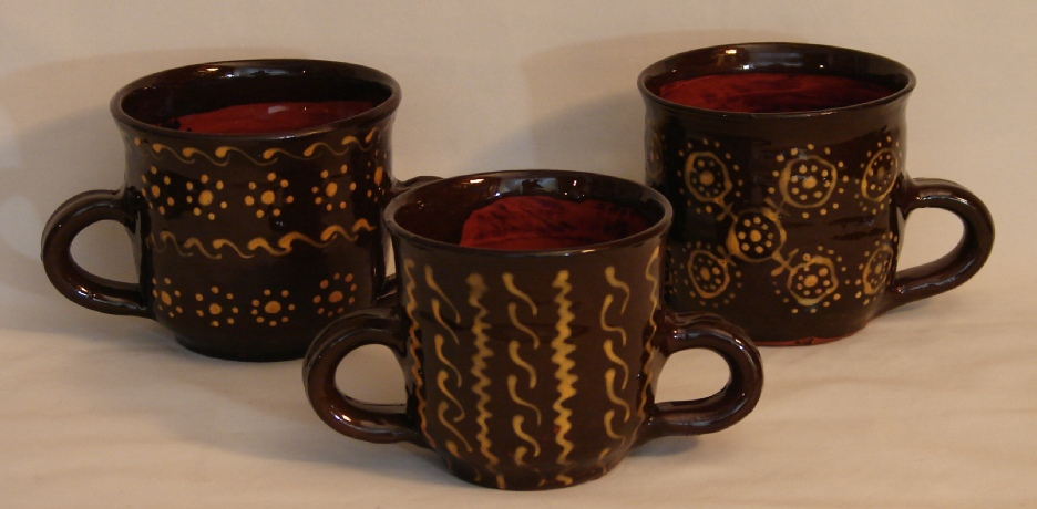 two handled bowls, aka redware posset pots