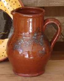 spangled redware pitcher front
